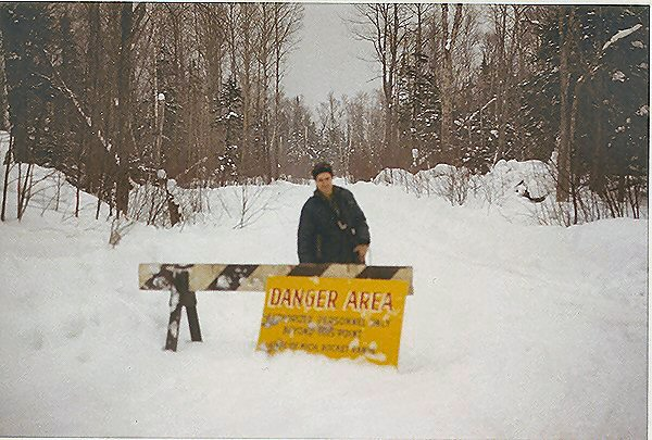 Roland Burgan at road warning sign 2 miles E. of Copper Harbor.