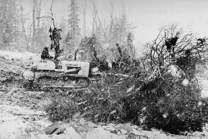 A bulldozer clearing brush from the launch site