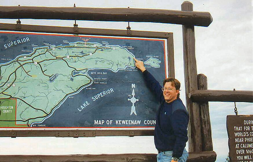 Glen E. Swanson pointing out the location of the KRB